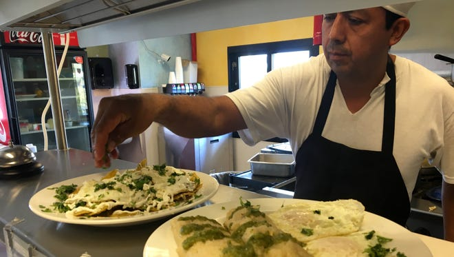 Cesar Cortes sends out two breakfast orders at Village Tex-Mex, the restaurant he opened Dec. 15 in North Fort Myers.