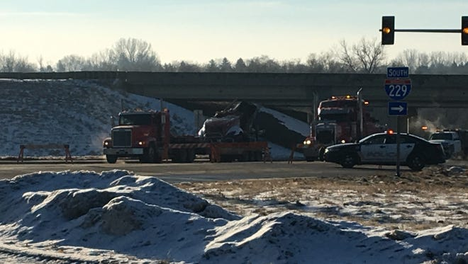 A semi fell off the I-229 bridge at Minnesota Avenue, killing one and injuring another, Sunday Jan. 15, 2017.