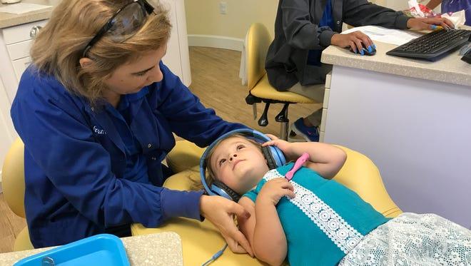Dr. Idaigna Alvarez checks out Isabella at Sunshine Smiles Pediatric Dentistry in Suntree.