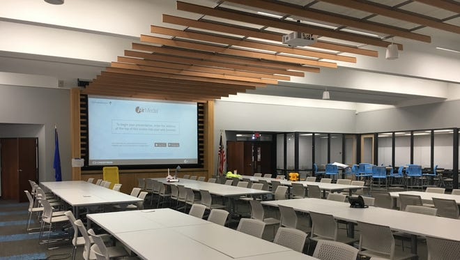 St. Thomas More High School's new Learning Commons, designed by Plunkett-Raysich architects, features a large presentation room with a 198-inch, high-definition Crestron projection screen.