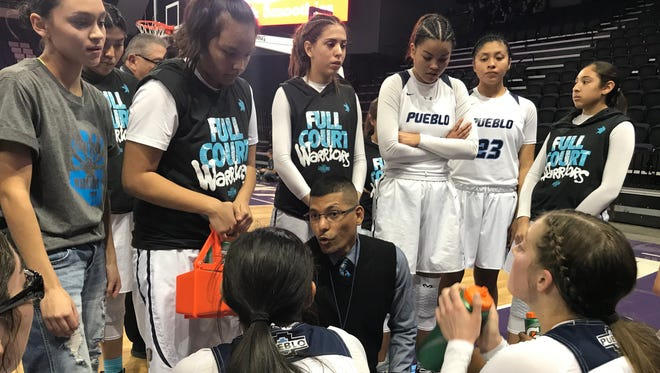 Pueblo head coach Ismael Galindo talks to his team during a timeout against Flagstaff in the 4A semifinals.