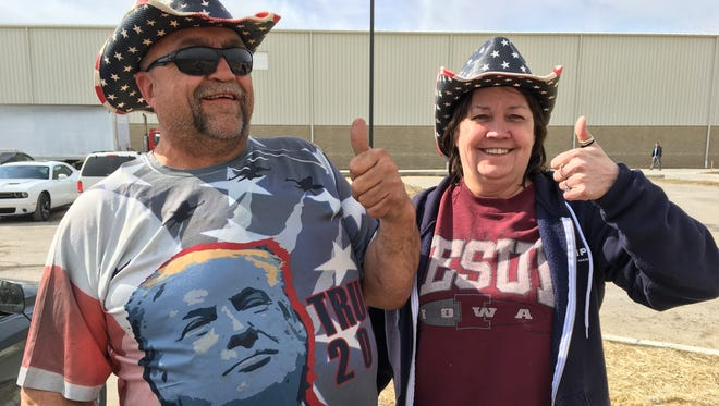 Randal Thom, 58, left, drove 850 miles from southwest Minnesota and picked up friend Cindy Hoffman, 57, in Iowa to show support for President Donald Trump at his rally at Total Sports Park in Washington Township, Michigan on Saturday, April 28, 2018.