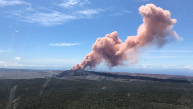 In this photo, provided by the U.S. Geological Survey, red ash is pictured rising from the Puu Oo vent on Hawaii's Kilauea Volcano after a magnitude-5.0 earthquake struck the Big Island on Thursday.