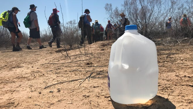 Volunteers with No More Deaths, Ajo Samaritans, and visiting clergy drop off water at the Cabeza Prieta National Wildlife Refuge in southern Arizona on August 5, 2018.