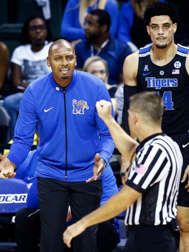 Memphis head coach Penny Hardaway (left) questions