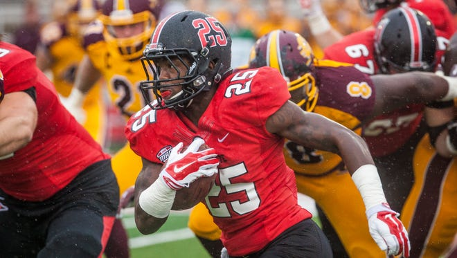 Ball State's Darian Green attempts to run past Central Michigan's block Saturday. Ball State lost against Central Michigan with a final score of 23-21.