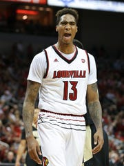 U of L's Ray Spalding (13) celebrates hitting a tough shot against the Purdue defense during their game at the KFC Yum! Center.  Nov. 30, 2016