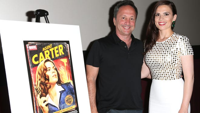 Director/Co-President Marvel Studios Louis D'Esposito, left, and actress Hayley Atwell attend the Marvel One-Shot San Diego Comic Con screening of 'Agent Carter.'