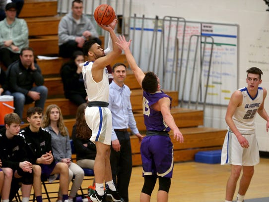 Jaiden Mosley is averaging 16 points per game this season for Olympic's boys basketball team.