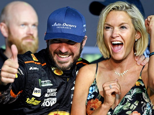 Martin Truex Jr. (78) celebrates with his girlfriend Sherry Pollex after winning the NASCAR Cup Championship after the Ford EcoBoost 400 at Homestead-Miami Speedway