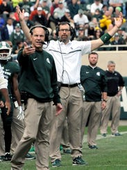 Mark Dantonio, left, and offensive line coach Mark