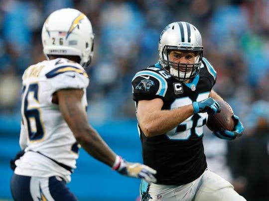 Carolina Panthers tight end Greg Olsen runs after a