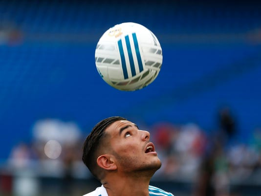 FILE - This is a Monday, July 10, 2017  file photo of Real Madrid's new signing Theo Hernandez as he heads the ball during his official presentation at the Santiago Bernabeu stadium in Madrid. (AP Photo/Francisco Seco, File)