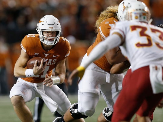 AUSTIN, TX - NOVEMBER 17:  Sam Ehlinger #11 of the Texas Longhorns scrambles in the first quarter defended by Braxton Lewis #33 of the Iowa State Cyclones at Darrell K Royal-Texas Memorial Stadium on November 17, 2018 in Austin, Texas.  (Photo by Tim Warner/Getty Images)