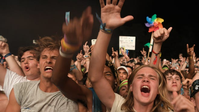 Fans cheer as Travis Scott  performs on the final night of the Bonnaroo Music & Arts Festival in Manchester, Tenn., on June 11, 2017.