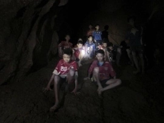 FILE - This Monday, July 2, 2018, file image released by Tham Luang Rescue Operation Center, shows the missing boys and their soccer coach as they were found in a dark, partially flooded cave, in Mae Sai, Chiang Rai, Thailand. The group was discovered July 2 after 10 days totally cut off from the outside world, and while they are for the most physically healthy, experts say the ordeal has likely taken a mental toll that could worsen the longer the situation lasts. (Tham Luang Rescue Operation Center via AP, File)