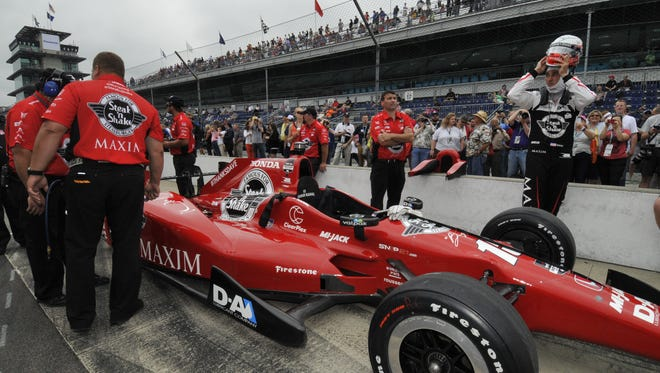 Graham Rahal prepares to climb into his car in the qualifying line on Saturday May 16th 2015 at the Indianapolis Motor Speedway.