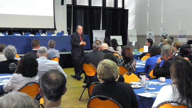 Paul Harriington, a labor expert, speaks to a crowd of business leaders at SUNY New Paltz Wednesday.