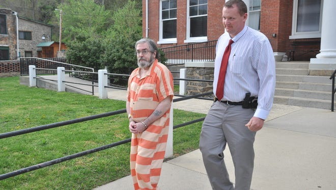 James Lagrua exits the Madison County Courthouse April 17 in the custody of Madison County Sheriff's Office Chief Deputy Coy Phillips.