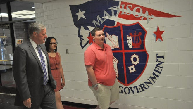 Congressman Mark Meadows walks the halls of Madison High School lead by student council officers Jake Matthews and Hong Pham.