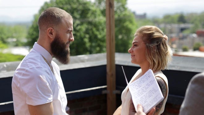 Brett Epps and Alixandra Cirigliano exchange wedding vows in Asheville, N.C. on Saturday.