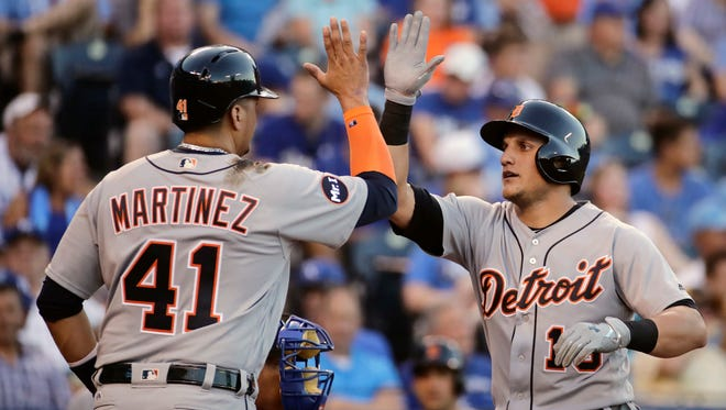 Tigers centerfielder Mikie Mahtook, right, celebrates with designated hitter Victor Martinez (41) after hitting a two-run home run during the third inning on Monday, July 17, 2017, in Kansas City, Mo.