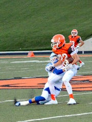 Artesia's Chaney Hardt fights for extra yards against