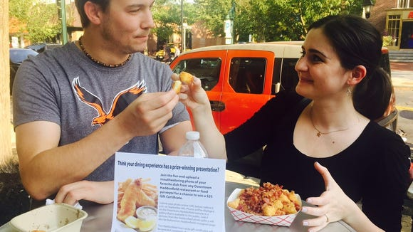 Visitors to Haddonfield Night Market toast each other with tots.