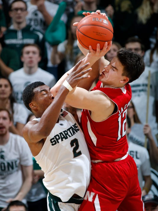 Nebraska's Michael Jacobson, right, and Michigan State's Javon Bess (2) collide while going for a rebound during the second half of an NCAA college basketball game, Wednesday, Jan. 20, 2016, in East Lansing, Mich. Bess was call for his fifth foul on the play. Nebraska won 72-71. (AP Photo/Al Goldis)