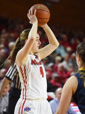 Marist College's Allie Clement looks for a teammate to pass to against Canisius at Marist on Saturday.