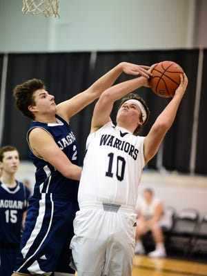 Lutheran Westland's Luke Smith (10) puts up a shot over the outstretched arm of Frankel Jewish Academy's Ryan Otis (2).