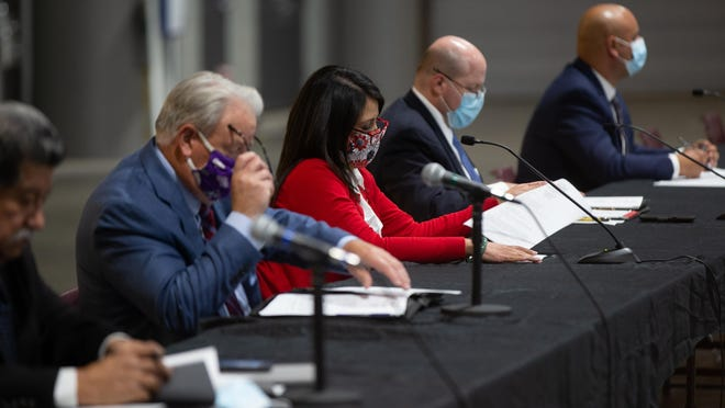 From left, Bill Riphahn, Michelle De La Isla, Kevin Cook and Aaron Mays listen to a presentation during Wednesday's Joint Economic Development Organization meeting. The JEDO board voted unanimously to approve economic incentive contracts with multiple local companies looking to expand their operations in Shawnee County.