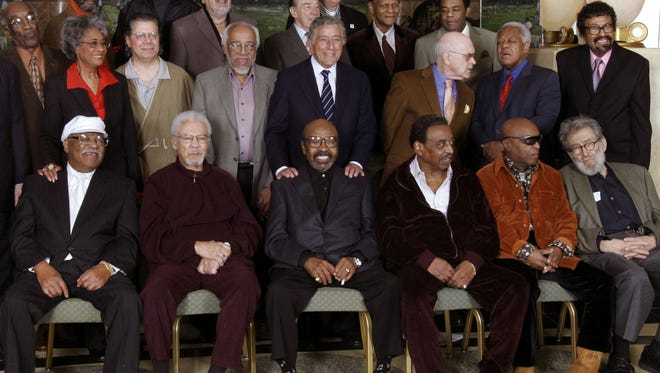In this 2006 file photo, jazz legends pose for a group portrait of National Endowment for the Arts Jazz Masters in New York. At right foreground  is writer Nat Hentoff.