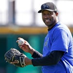 In this Feb. 12, 2014, photo, retired NBA basketball player Tracy McGrady smiles while working out at the Sugar Land Skeeters' baseball stadium in Sugar Land, Texas. McGrady signed Wednesday, April 23, to pitch for the Skeeters in the independent Atlantic League. (AP Photo/Pat Sullivan) ORG XMIT: NY168