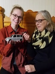 Nicky Bauerkemper, left, holds a remote control version