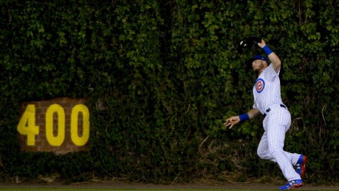 Chicago Cubs center fielder Ian Happ (8) catches a fly ball hit by Cincinnati Reds catcher Tucker Barnhart (16) in the sixth inning  at Wrigley Field on May 17.