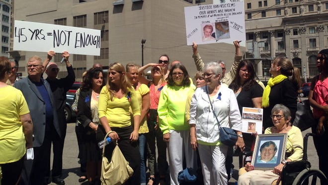 Family and friends of victims of Dr. Farid Fata react to his sentencing on Friday, July 10, 2015. Fata received 45 years in federal prison at U.S. District Court in Detroit.