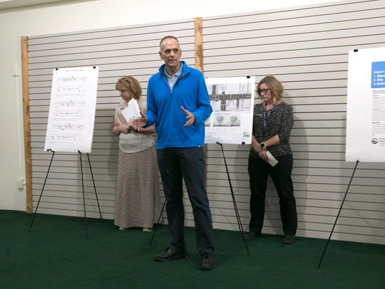 Farmington Mayor Tommy Roberts addresses community members and Main Street business owners Tuesday at the Complete Streets headquarters in Farmington.