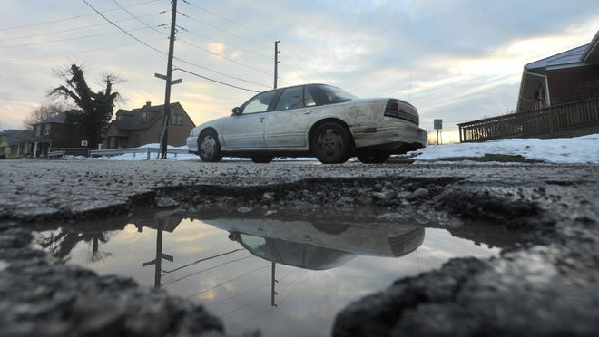 """According to @PotholesOfIndy, a Twitter account """"defending"""" potholes, they're just peaceful potholes."""