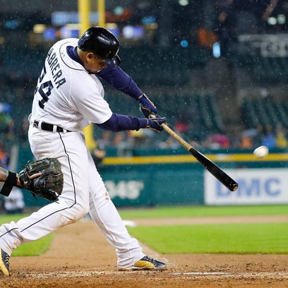 Tigers' Miguel Cabrera hits a three-run home run during