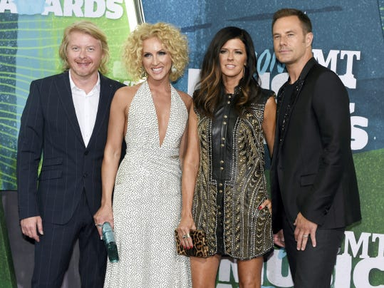 From left, Phillip Sweet, Kimberly Schlapman, Karen Fairchild and Jimi Westbrook of Little Big Town arrive at the CMT Music Awards last June. The group is tied with Eric Church with five nominations each at this year's Country Music Association Awards. Carrie Underwood and Brad Paisley will host the Nov. 4 awards show.