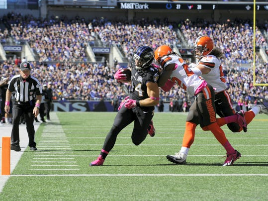 Baltimore Ravens' Kyle Juszczyk (44) catches a touchdown pass from Joe Flacco during the first quarter on Sunday at M&T Bank Stadium in Baltimore.