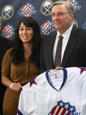 Terry Pegula and his wife Kim during a news conference after buying the Rochester Americans hockey team. They also own the Sabres, and are on their way to owning the Buffalo Bills, as well.