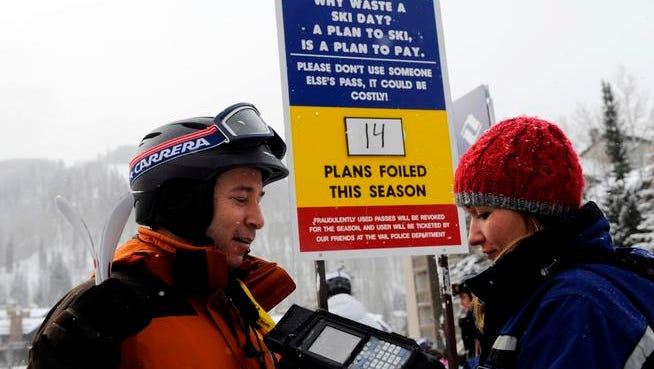 (KL) Casey Ognevyuk, right, is scanning a ticket, which brings up a photograph of the skier's face, their height, weight. In Vail, there has been some trouble recently with non-resort workers offering ski instruction, a violation of federal law.  In the resort  number of lift ticket fraud incidents are growingl. The resort is working to stem fraud with different strategies. Hyoung Chang/ The Denver Post
