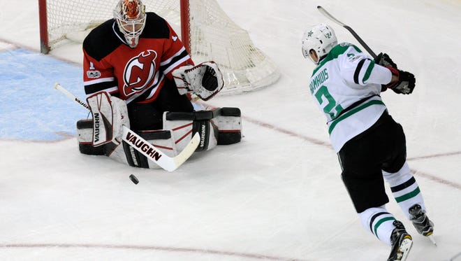New Jersey Devils goalie Keith Kinkaid (1) deflects a shot by Dallas Stars defenseman Dan Hamhuis (2) during the second period of an NHL hockey game Sunday, March 26, 2017, in Newark, N.J. (AP Photo/Bill Kostroun)