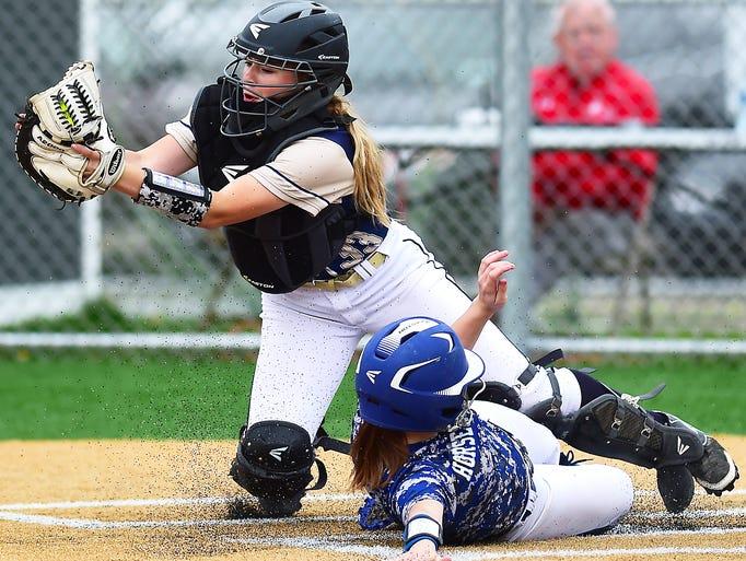 Susquehanna Valley catcher Emily DeMoney (33)) attempts