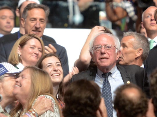 Vermont Democratic delegate Aster O'Leary, left, stands with Sen. Bernie Sanders after a brief embrace at the Democratic National Convention in Philadelphia on Tuesday, July 26, 2016.