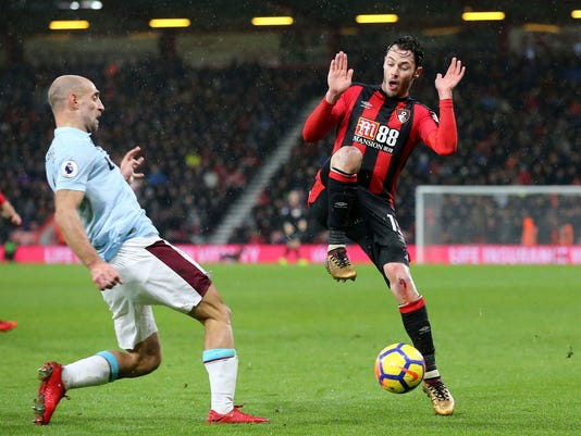 West Ham United's Pablo Zabaleta, left, and AFC Bournemouth's Adam Smith battle for the ball during their English Premier League soccer match at the Vitality Stadium, Bournemouth, England, Tuesday, Dec. 26, 2017. (Mark Kerton/PA via AP)