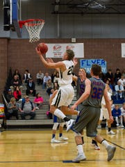 Desert Hills basketball takes on Richfield during the Ken Robinson Classic Friday, Dec. 12, 2016.