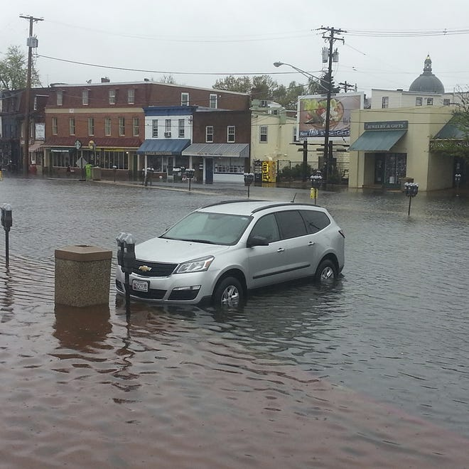 A  car is surrounded by floodwater in Annapolis, Md., in April.  The city can expect more than 150 tidal floods a year by 2030.